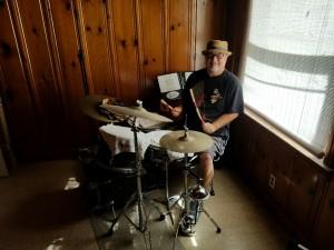 Joe in rehearsal studio with Levon's sticks.  Photo by JB John Black